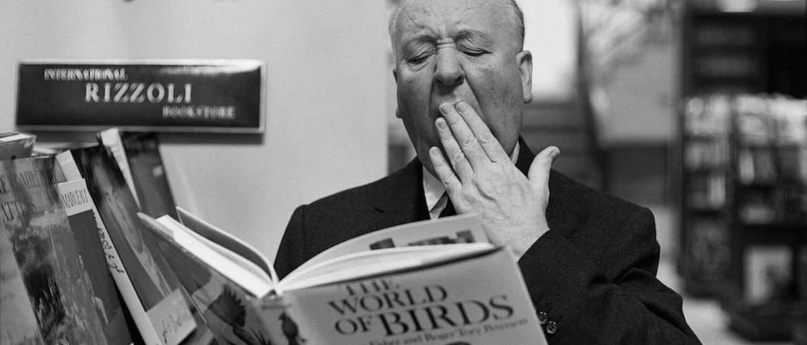 "Original Caption: 2/16/1965-New York, NY-Alfred Hitchcock won't reveal the subject of his next movie, but he's obviously bored with the former friends who starred in his scare-film ""The Birds.""  The maestro of mayhem was caught in the ""ho hum"" mood when he dropped in at the Rizzoli Bookstore on New York's Fifth Avenue, to check on the latest ""Ghoulology."""