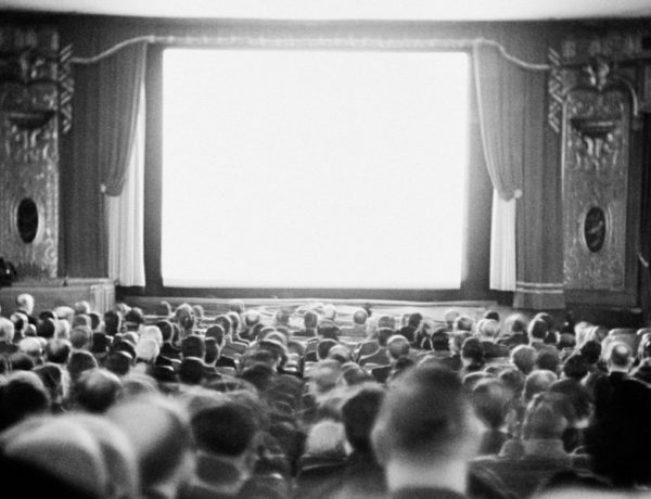AUDIENCE IN MOVIE THEATER, 1935